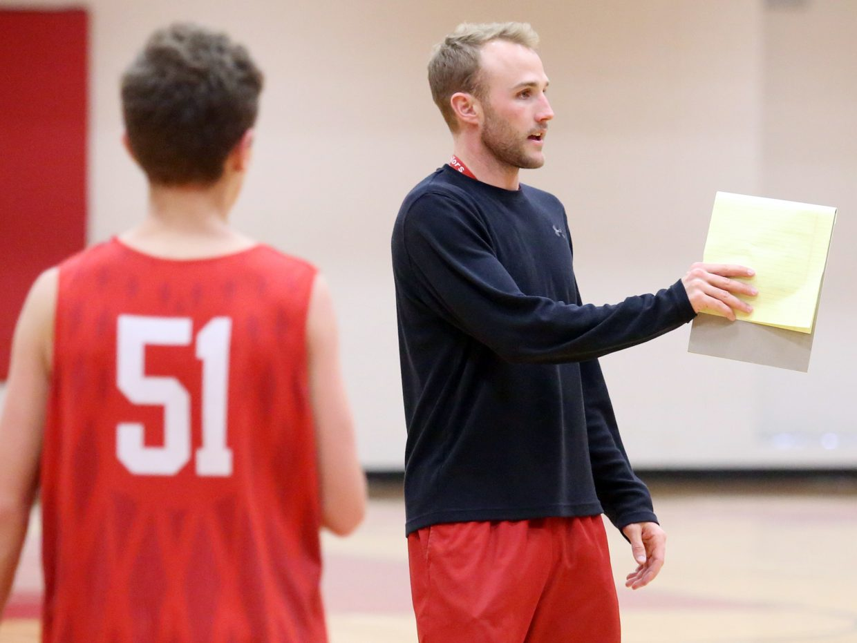 Steamboat Springs High School boys basketball coach Michael Vandahl instructs players during practice on Thursday.