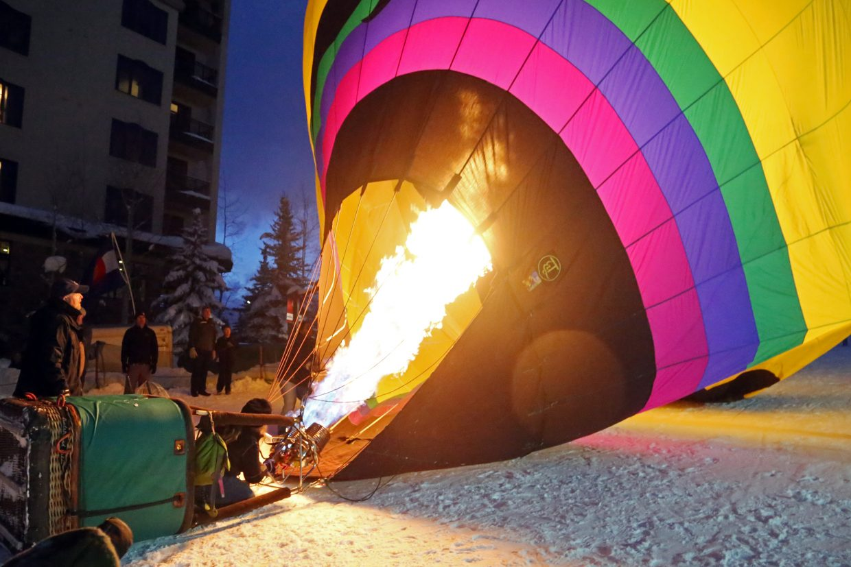 A balloon gets filled with hot air on Sunday during the Hot Air Balloon Glow at Steamboat Ski Area.