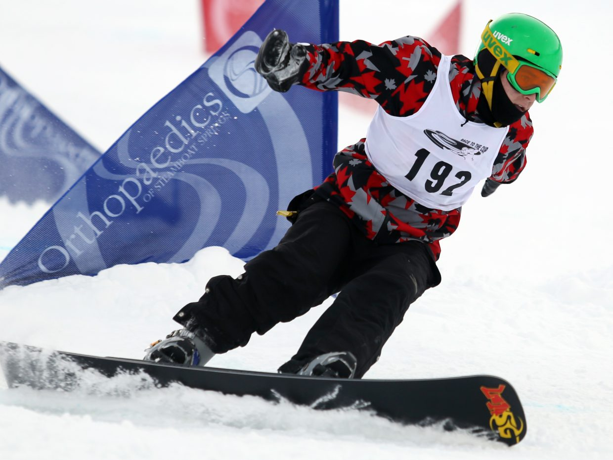 Canada's Emile Gaudet competes in Sunday's NorAm Race to the Cup parallel slalom snowboarding event at Howelsen Hill. Gaudet lost in the quarterfinals to eventual men's champion, Sebastien Beaulieu.