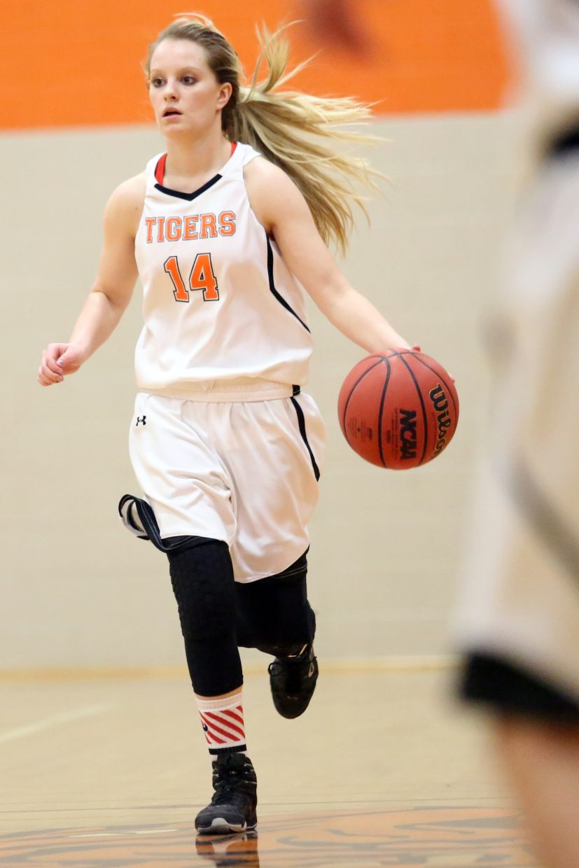 Hayden junior Grace Wilkie dribbles up court against West Grand on Friday.