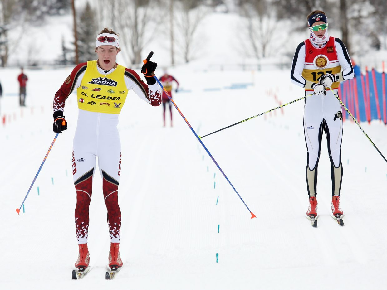 University of Denver Nordic skier Moritz Madlener, left, celebrates after edging University of Colorado's Mads Stroem in the Spencer James Nelson Memorial Invitational men's 20K cross country race on Sunday at Howelsen Hill.