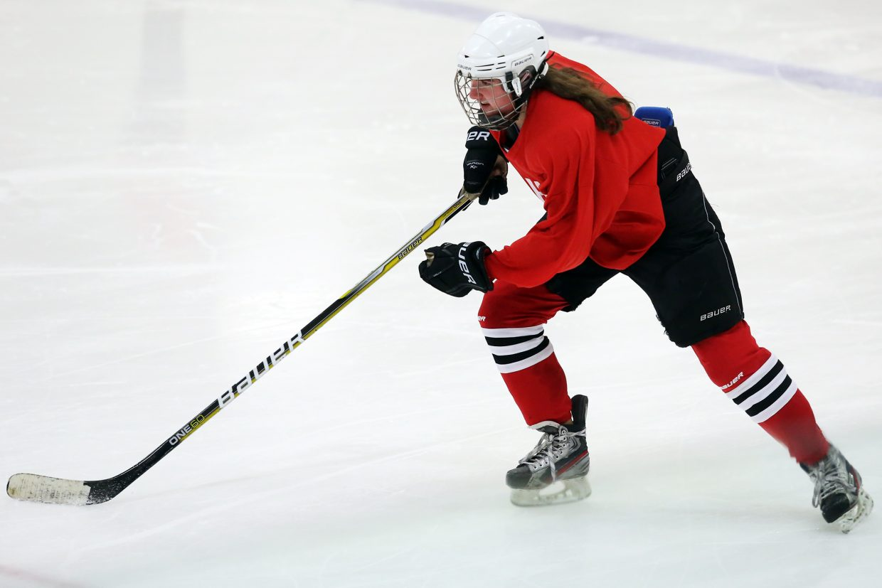 Maddie Thompson takes part in drills earlier this week at the Howelsen Ice Arena with the girls' U19 hockey team.