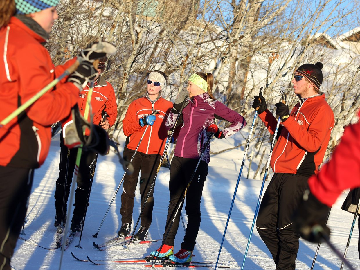 Members of the Steamboat Springs High School Nordic ski team listen to instructions during practice on Tuesday at the Ski Touring Center.