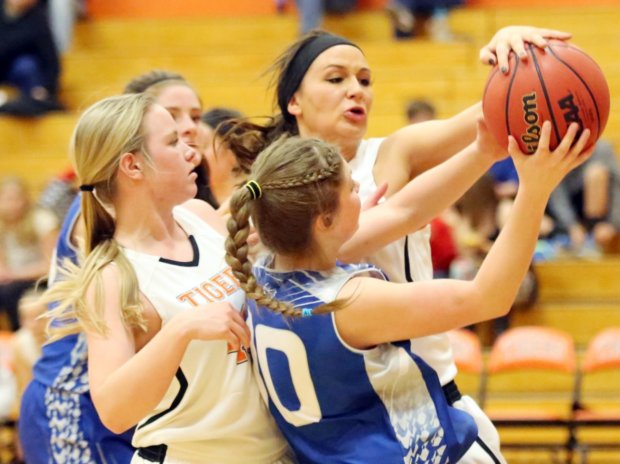 Hayden senior Emma Johnson, back right, blocks the shot of a De Beque player on Friday. The Tigers won 48-36 in Hayden.