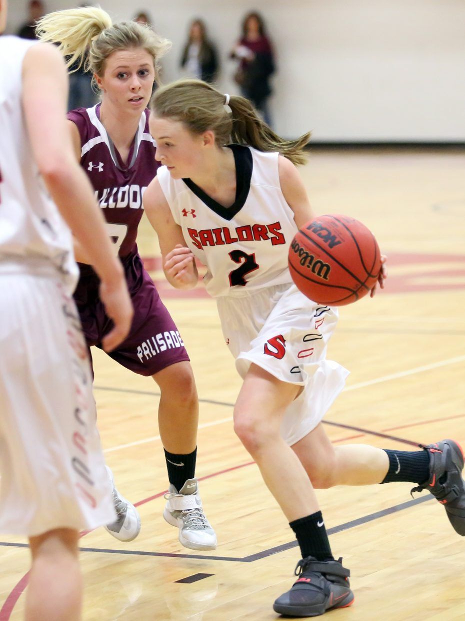 Steamboat Springs junior Raya Duryea drives to the basket against Palisade on Saturday.