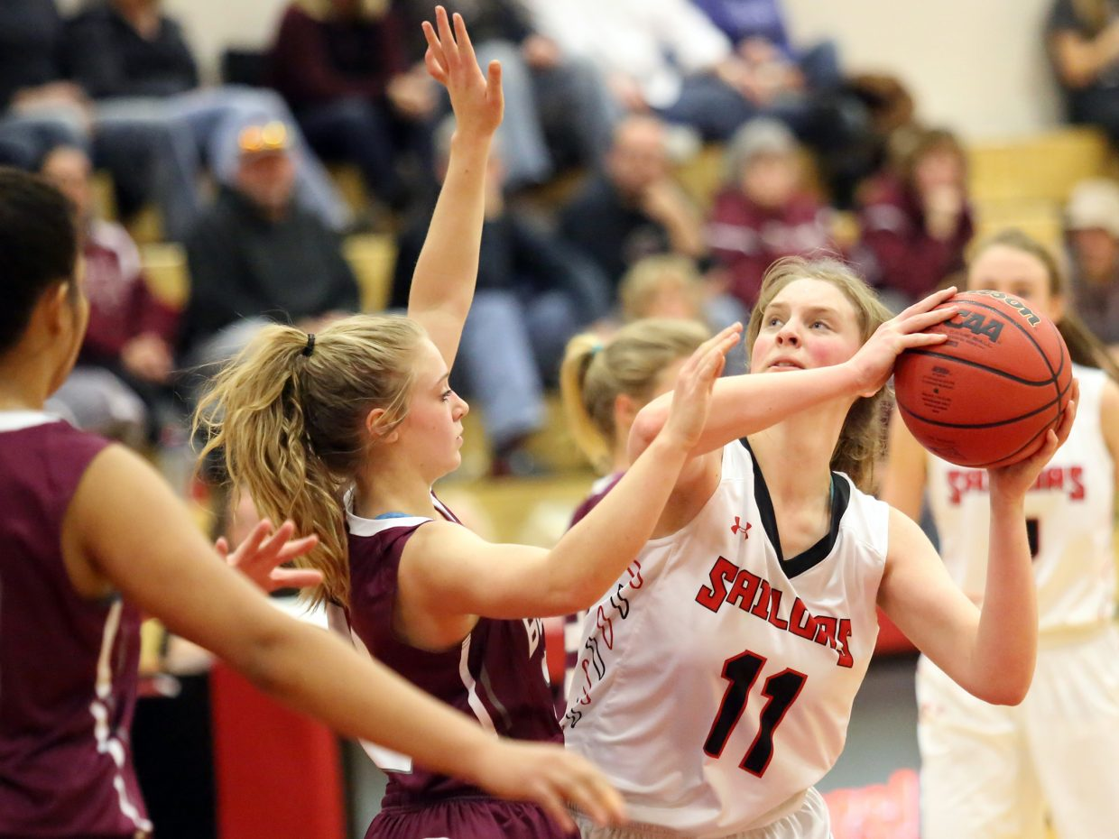 Steamboat Springs senior Annie Osbourn, right, looks for room to shoot against Palisade on Saturday inside the Kelly Meek gymnasium. The Sailors lost, 45-20.