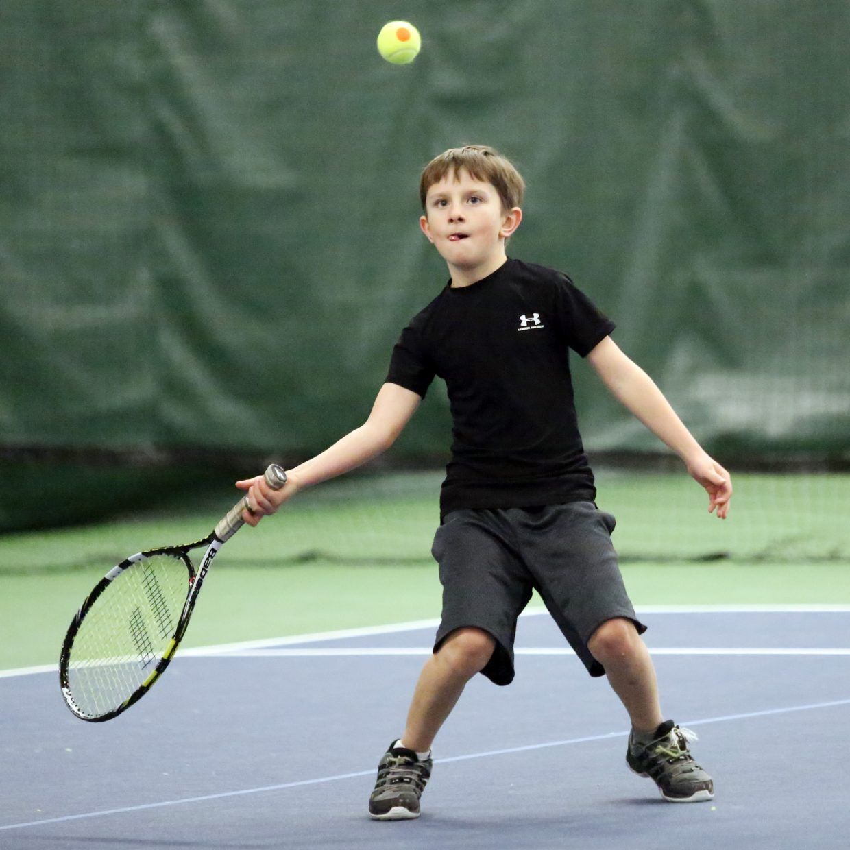 Alexander Craig competes in Sunday's Steamboat Springs City Adult MXD and Junior Championships at The Tennis Center.