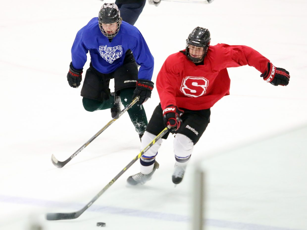 Two Steamboat Springs High School hockey players scrimmage during practice on Wednesday at the Howelsen Ice Arena. The Sailors host Battle Mountain on Friday.