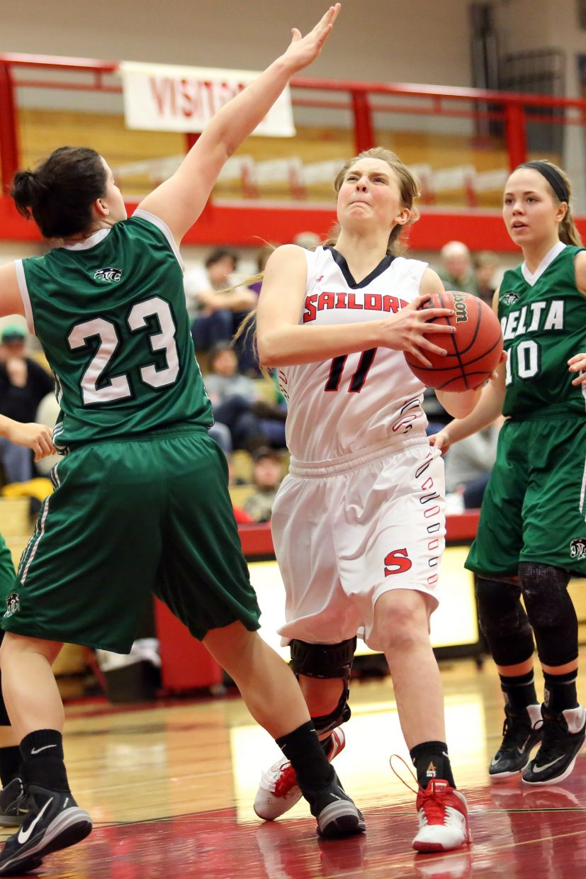 Steamboat senior Annie Osbourn searches for room in the paint against Delta on Saturday.