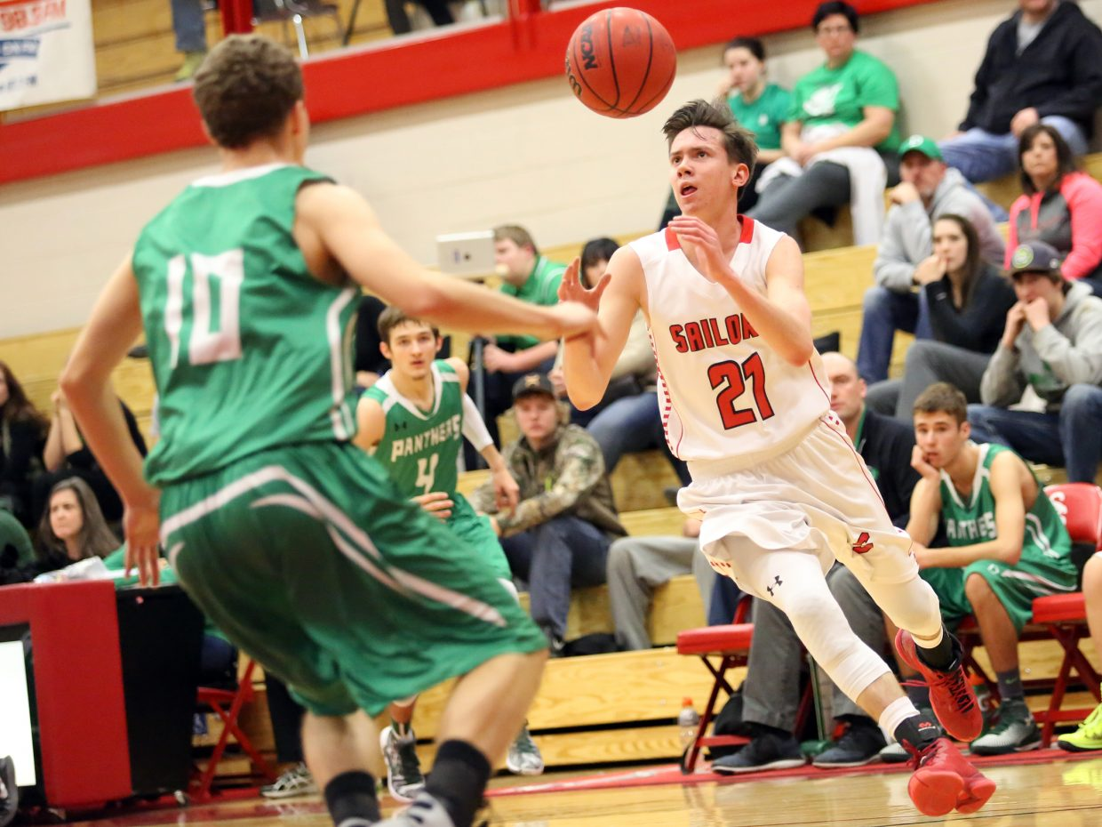 Steamboat Springs senior John Zalesky, right, tries to haul in an airborne basketball earlier this season against Delta. The Sailors will play at top-ranked Lewis-Palmer on Friday in the first round of the Class 4A state tournament.