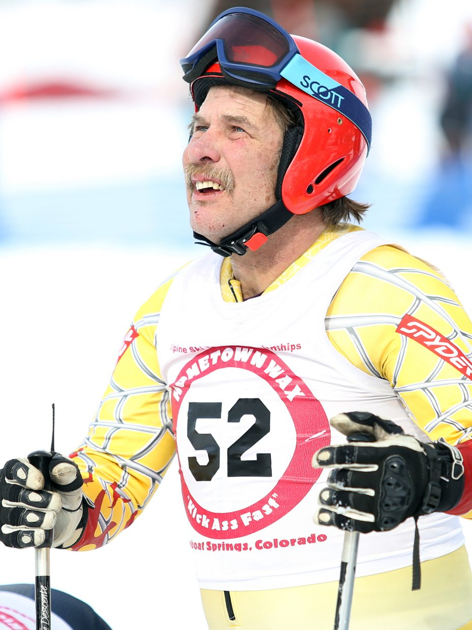 Tim Magill, a Routt County ski legend, keeps an eye on his fellow competitors Sunday during the pro Alpine ski jumping finals at Howelsen Hill.