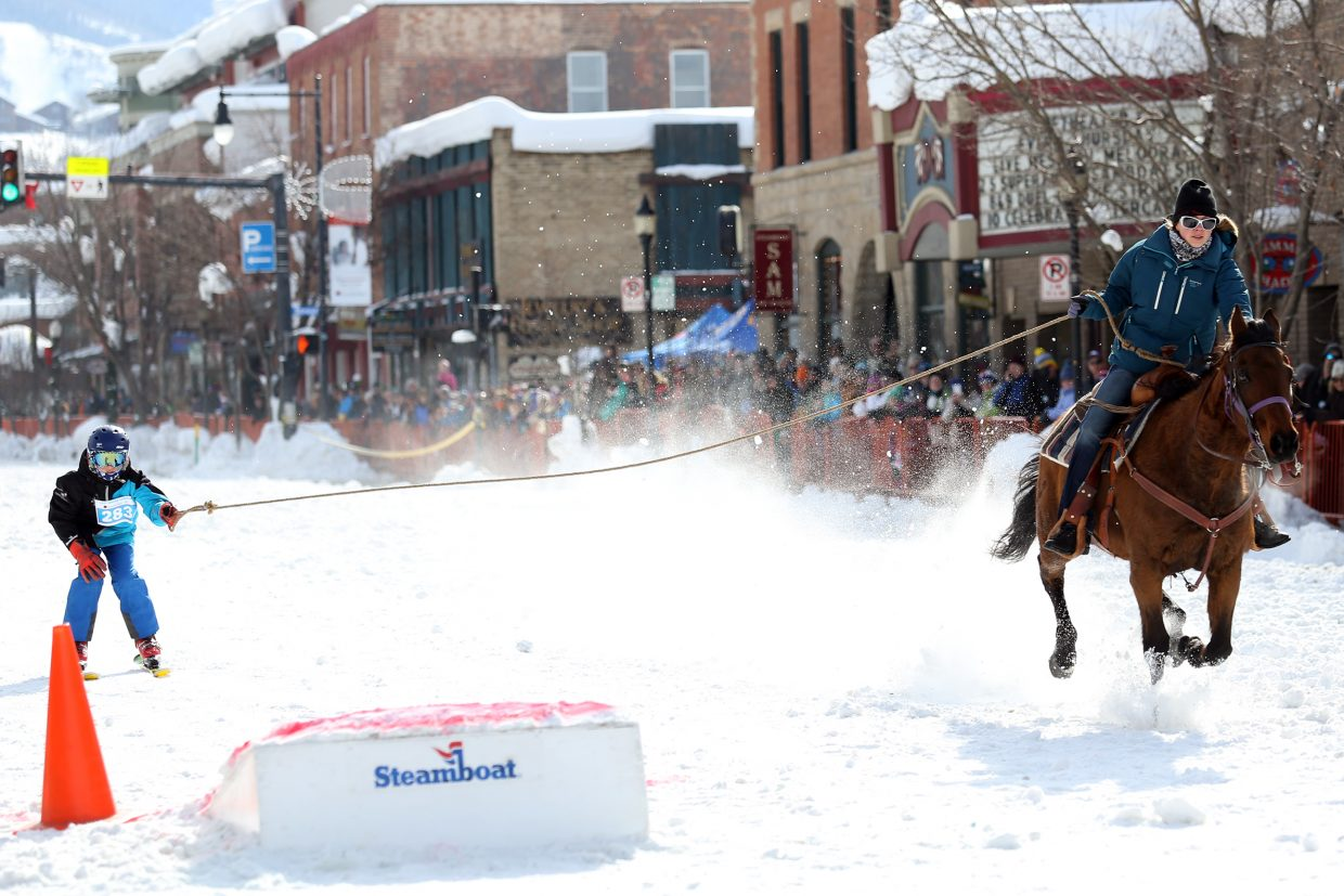 Winter Sports Club athlete Levi Allen competes in Sunday's Donkey Jump down Lincoln Avenue, part of the 103rd annual Winter Carnival.