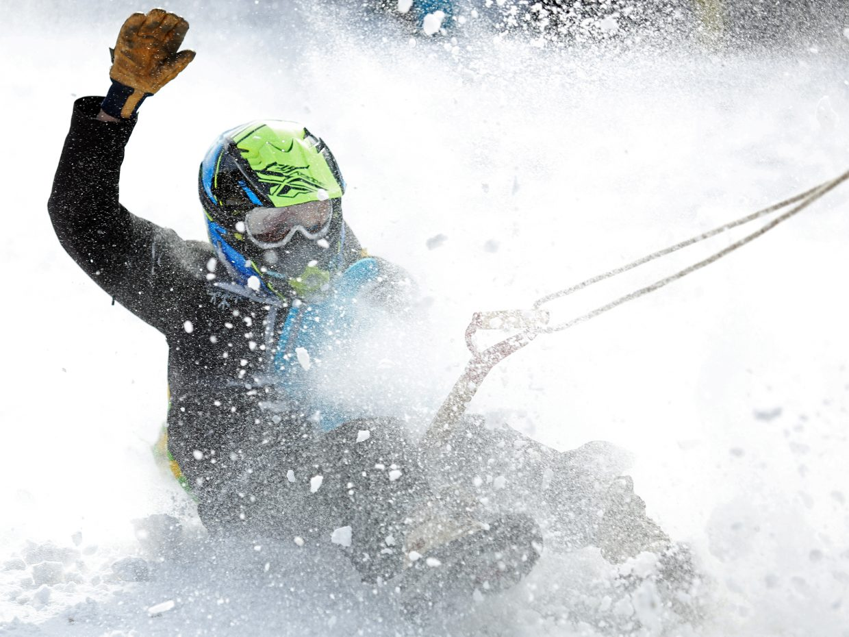 Rory Clow, who works for the Steamboat Springs Winter Sports Club, competes in Sunday's shovel race during the Winter Carnival.