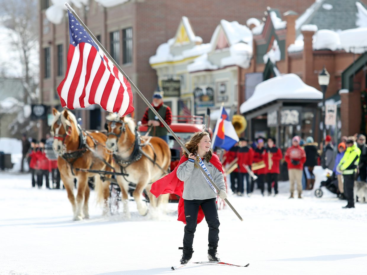Winter Carnival Queen Logan Sankey gets the Diamond Hitch Parade underway Sunday in downtown Steamboat Springs.