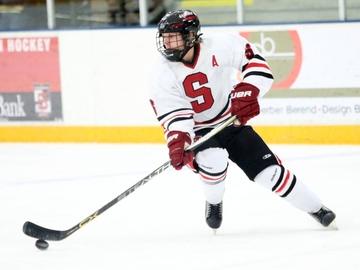 Steamboat Springs senior Brendan Selby controls the puck against Cherry Creek on Saturday at Howelsen Ice Arena.