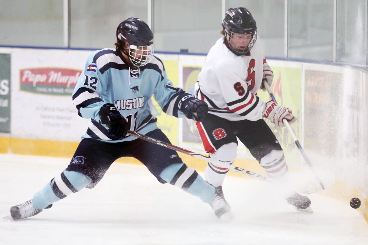 Steamboat Springs High School senior David Cropper, right, fights for the puck against a Ralston Valley player on Friday at Howelsen Ice Arena. The Sailors lost 6-0 in their regular-season finale.