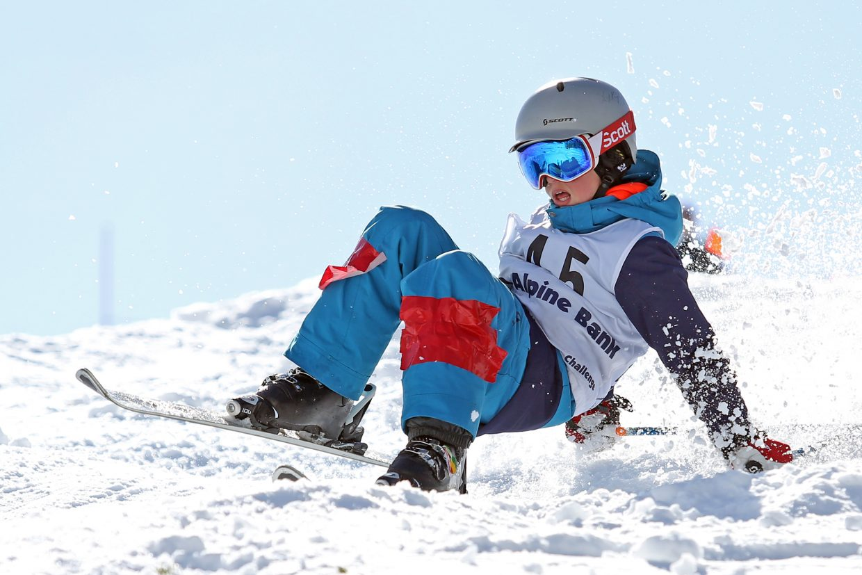 Vail's Tanner Roberts hits the ground hard after missing the landing on a jump during Saturday's Rocky Qualifier Series U15 open moguls ski competition at Steamboat Ski Area.