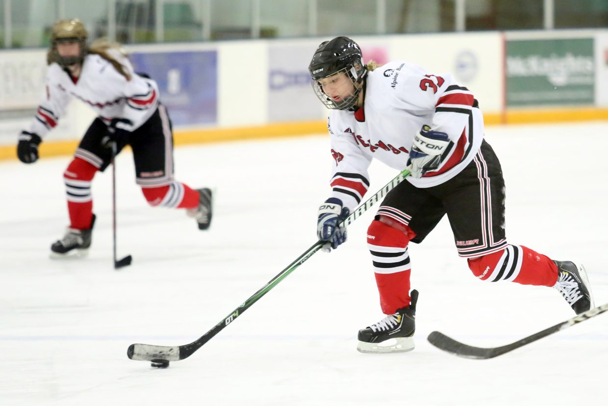 Steamboat's Quincey Pugh brings the puck up the ice against Colorado Select on Sunday at Howelsen Ice Arena.