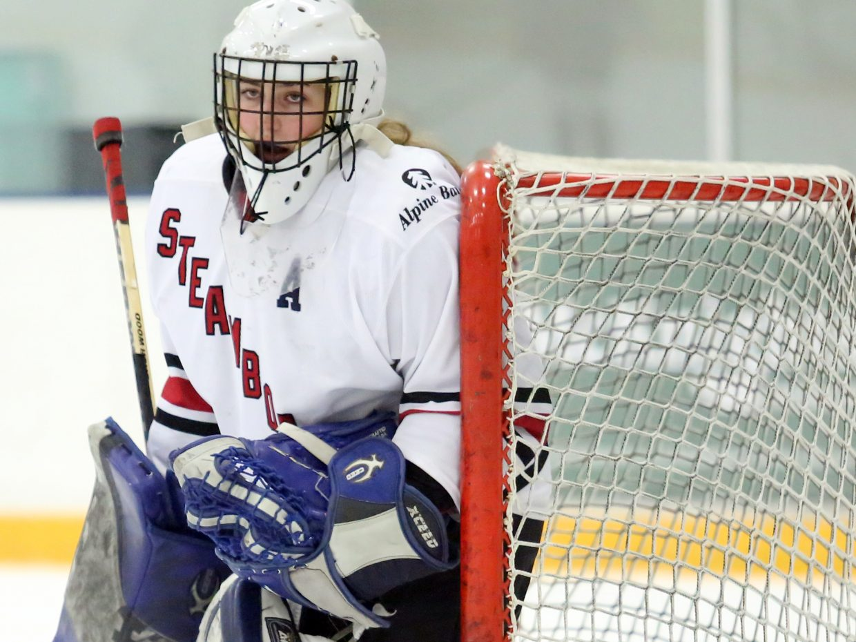 Steamboat goalie Tanner Stover eyes the action against Colorado Select on Sunday at Howelsen Ice Arena.