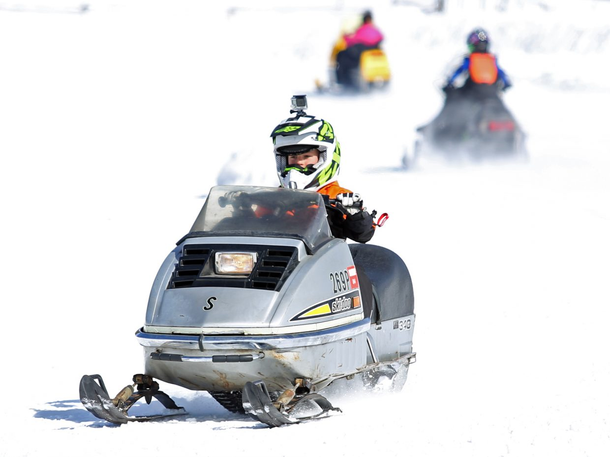Bodie Zamzow, 9, enjoys Sunday's fourth annual Vintage Snowmobile Rally at Hahn's Peak Roadhouse in North Routt.