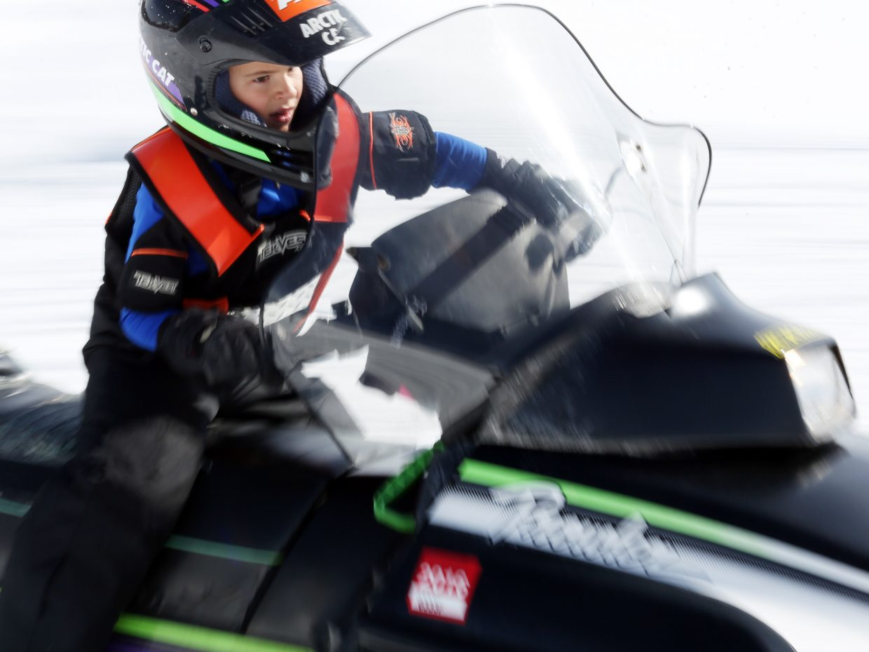 Carter Chase, 8, takes part in Sunday's fourth annual Vintage Snowmobile Rally at Hahn's Peak Roadhouse in North Routt.