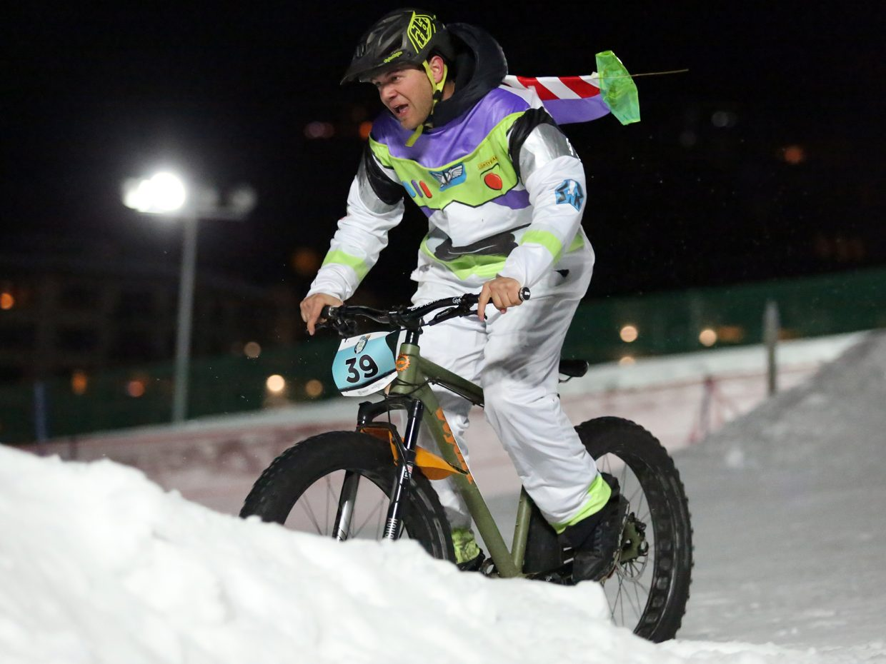 "Jay De Beer, dressed as Buzz Lightyear, competes in Friday's inaugural Cool Dual Bike Race at the Steamboat Ski Area. Jay De Beer was awarded ""Best Costume."""
