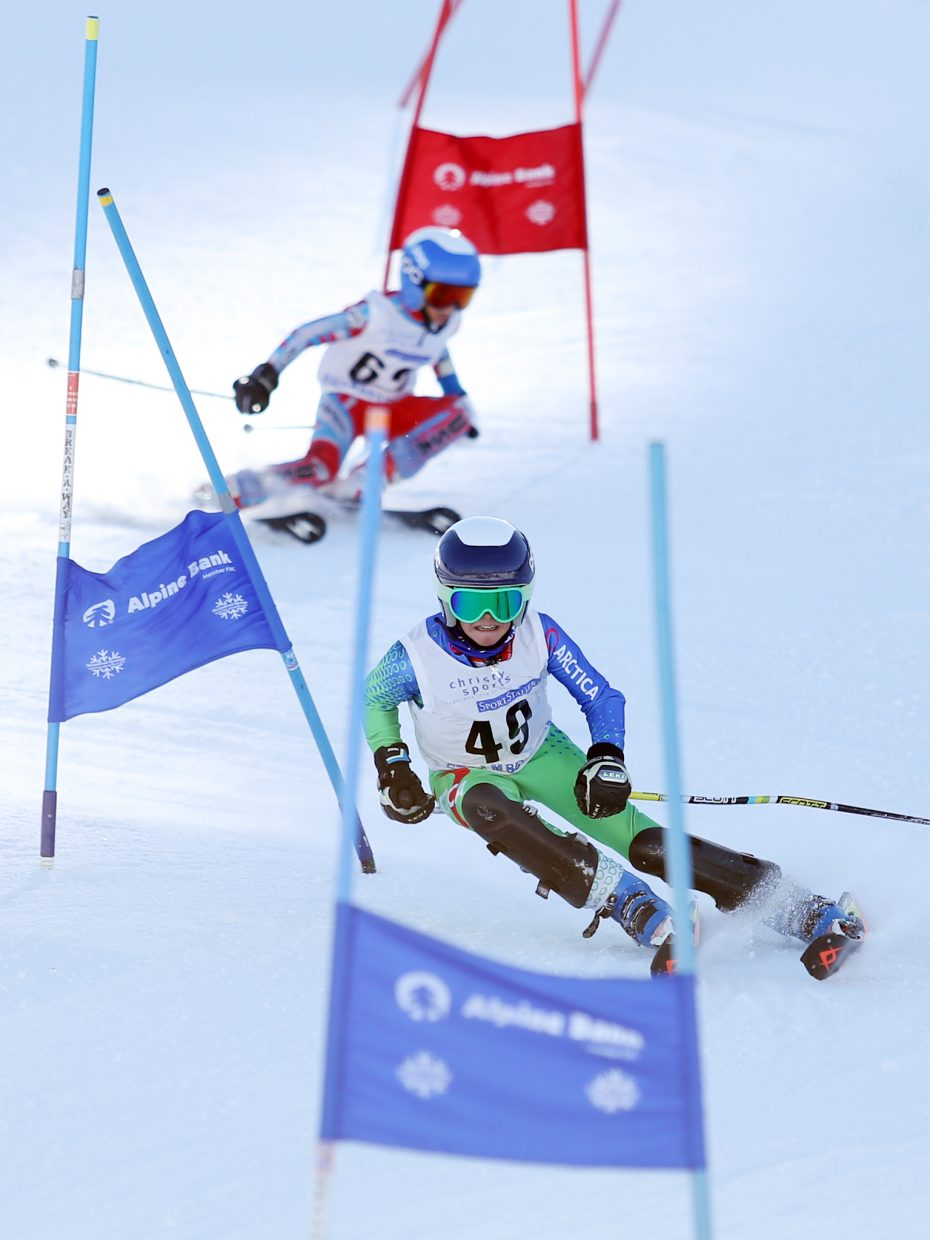 Cade Gedeon, front, leads Colin Kagan while competing in Saturday's Steamboat Cup Alpine skiing dual at Howelsen Hill. Gedeon was second and Kagan third in the U12 boys bracket.
