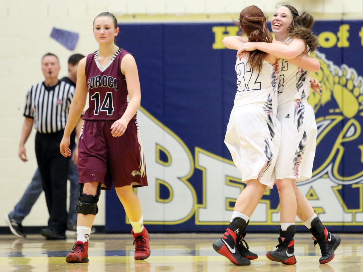 Soroco High School senior Briana Peterson, left, walks off the court while two Paonia players hug on Saturday in Rifle. The Rams' season ended with a 53-41 loss in the regional championship game.