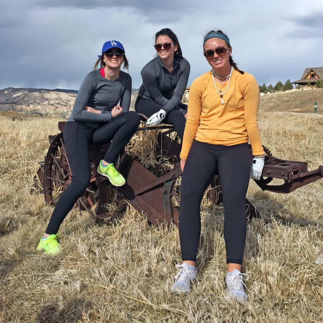 From left, Steamboat Springs High School golf team members junior Riley Toye, junior Kellyn Stanhope and senior Caroline Wheeler pose for a picture while at Gypsum Creek Golf Course on Friday.