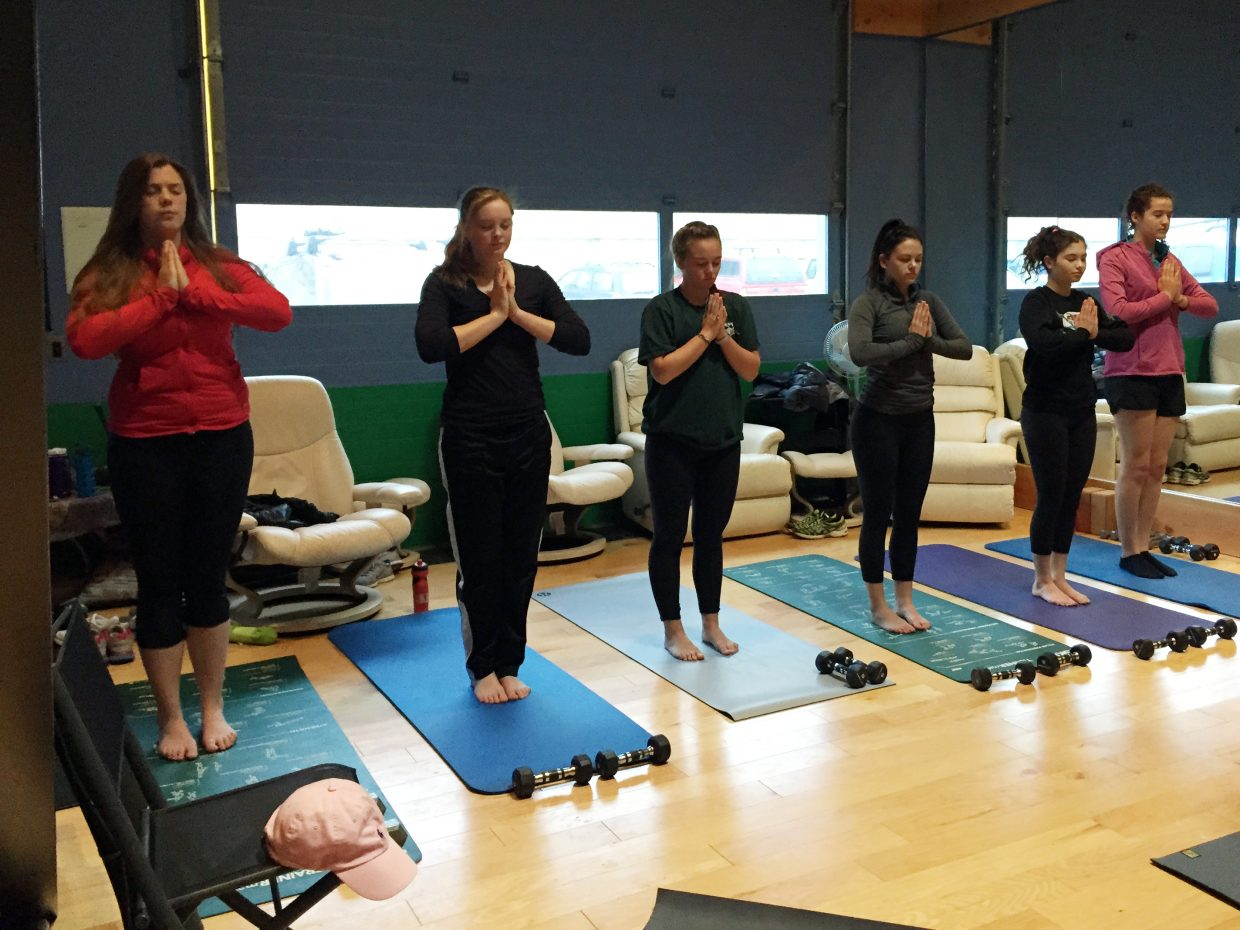 Members of the Steamboat Springs High School girls' golf team practice yoga at coach Shannon Hanley's studio.