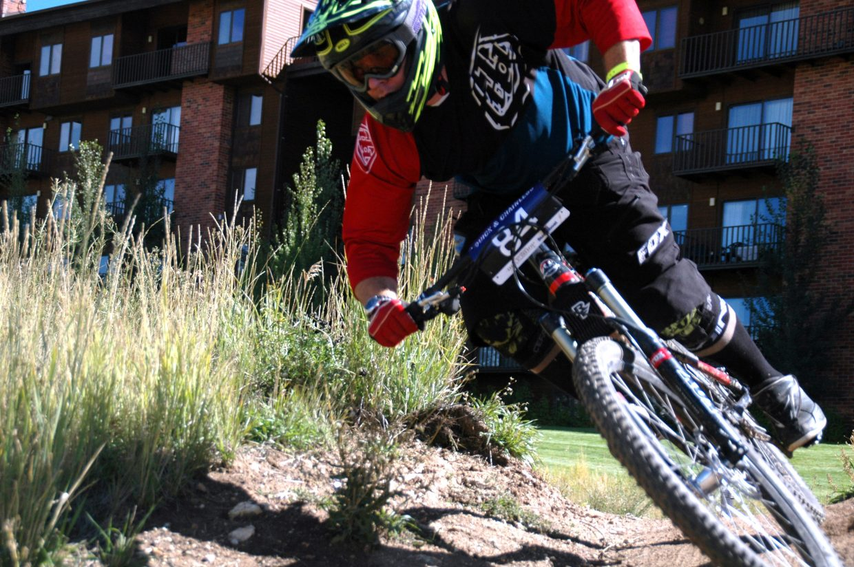 Men's elite winner James Koch takes on a turn during Sunday's Quick and Chainless Downhill Mountain Bike Race. Koch won by less than three seconds and said the conditions on the trail were perfect.