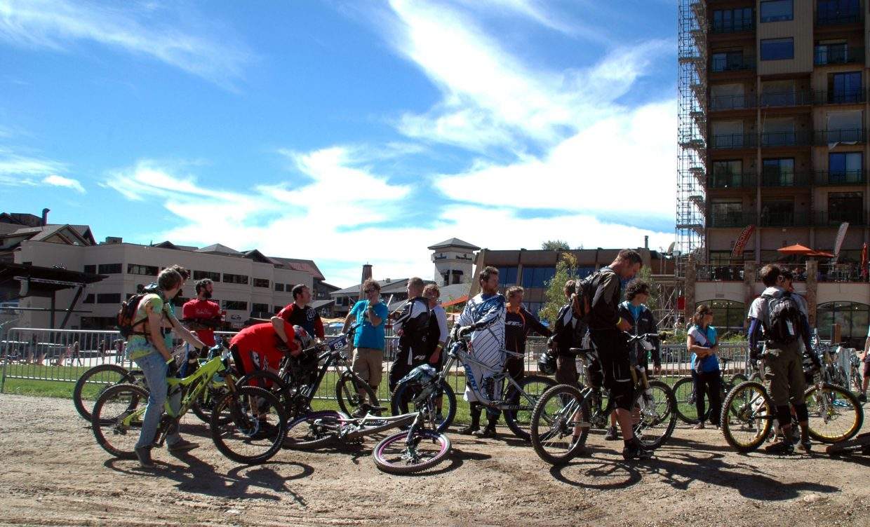 About midway through Sunday's Quick and Chainless Downhill Mountain Bike Race, finished competitors wait for those still at the top of the mountain. About 50 men, women and juniors raced.