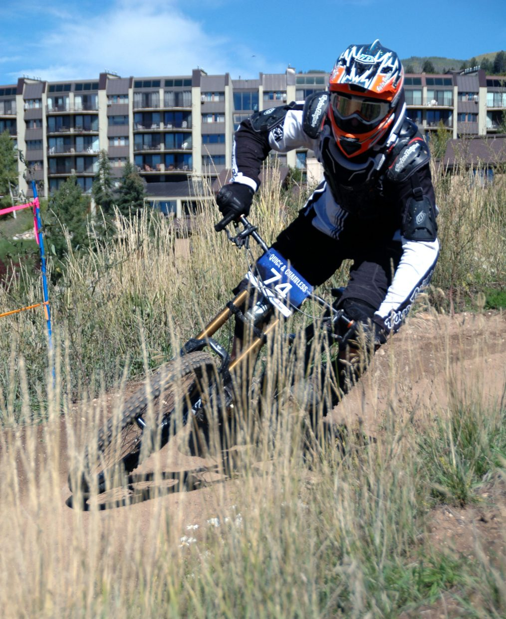 Grant Ingram enters one of the final turns during Sunday's Quick and Chainless Downhill Mountain Bike Race. Ingram finished 11th in the men's elite class in a time of 14:32.19.