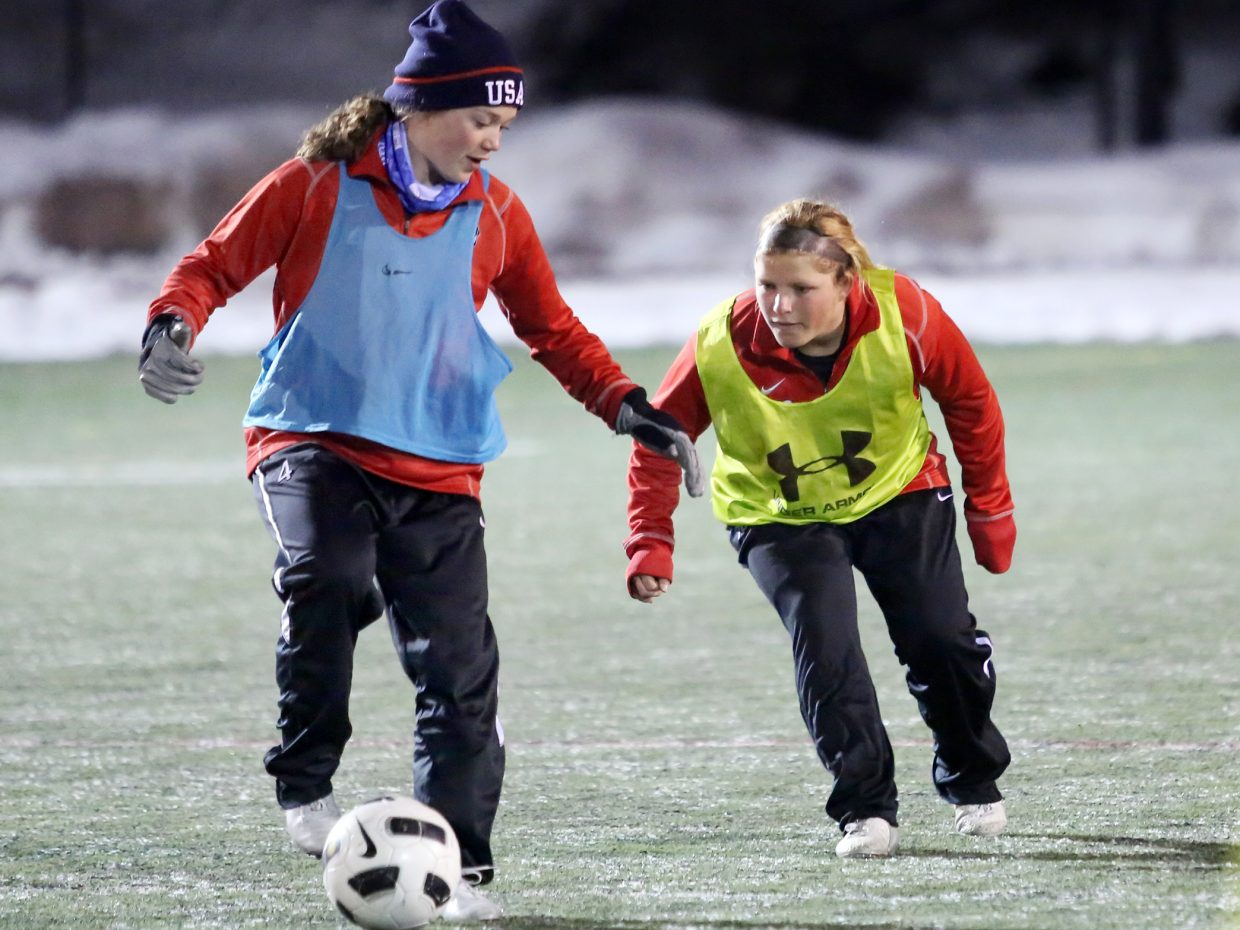 Ellese Lupori, right, and Logan Sankey run through drills Wednesday at Gardner Field. The Steamboat Springs High School girls' soccer team opens its season Friday at home against Middle Park.