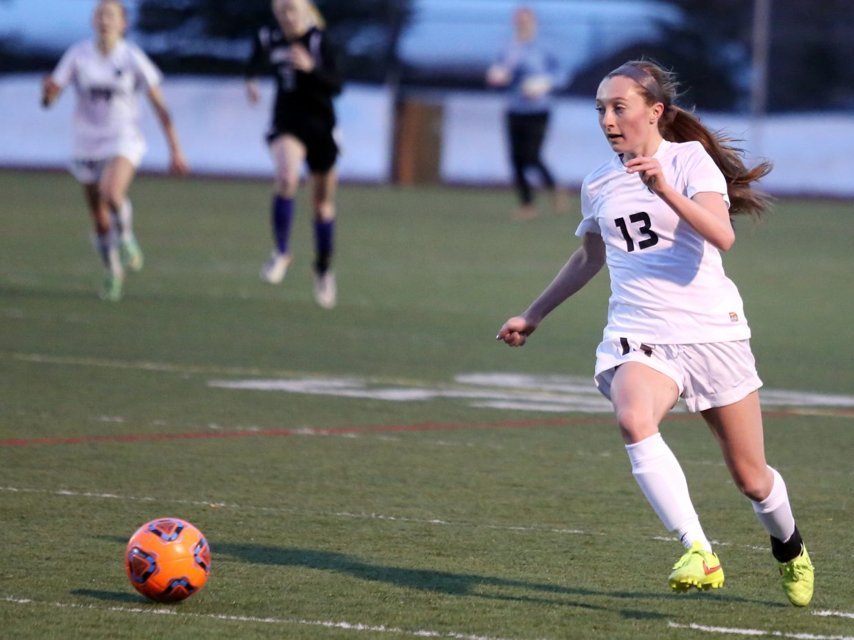 Steamboat Springs senior MacKenzie Gansmann dribbles up field against Middle Park on Friday at Gardner Field. The Sailors won their season opener, 9-0.