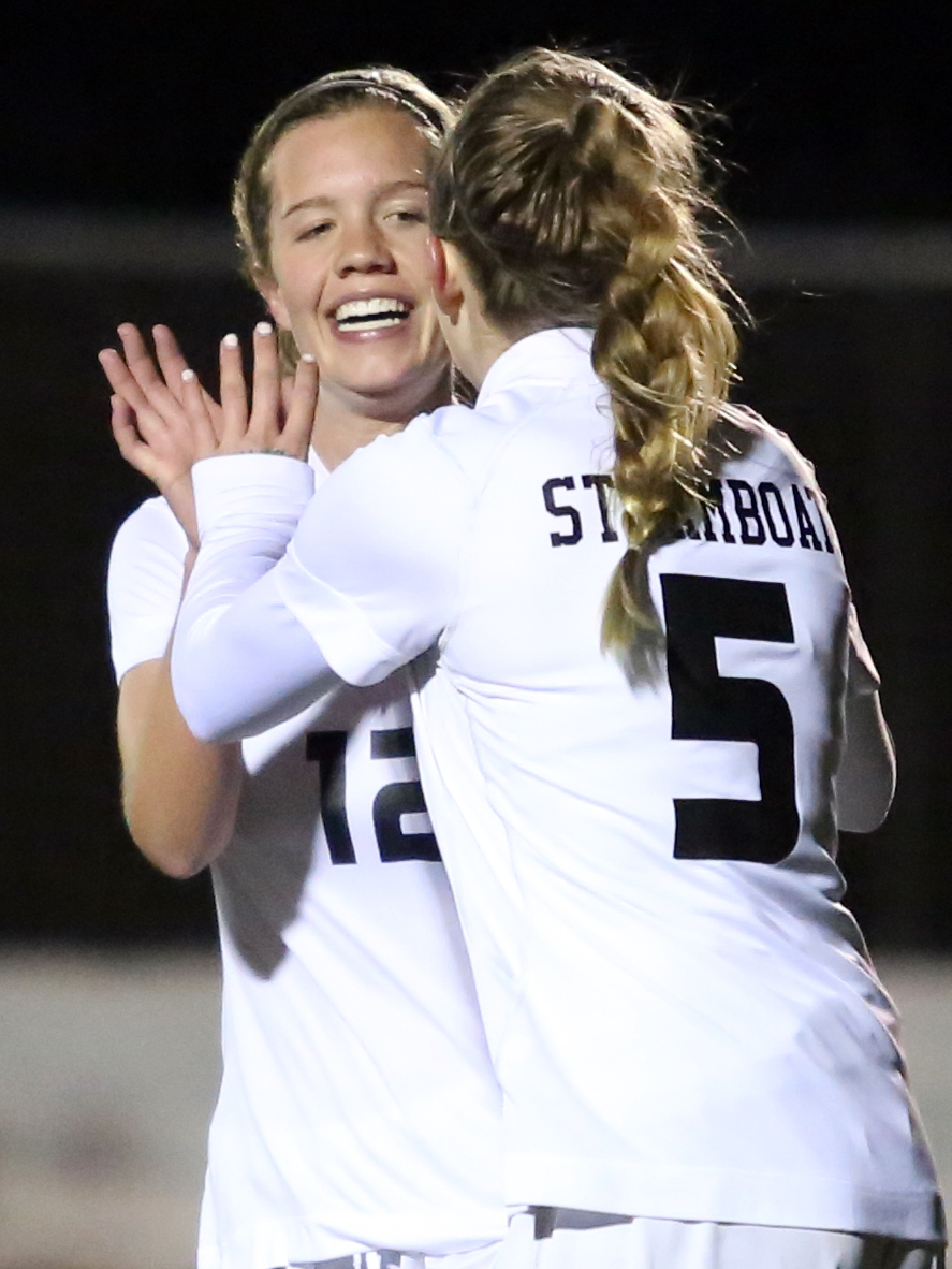 Steamboat Springs senior Natalie Bohlmann, left, celebrates with junior Brooke Buchanan after Buchanan's third goal of Friday's game against Middle Park.
