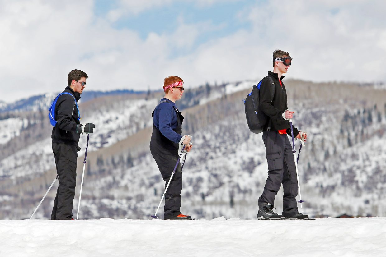 From left, Preston Tolbert, Nick James and Jack Guy enjoy Howelsen Hill's free ski day on Sunday. The Texas trio is visiting Steamboat Springs for spring break.