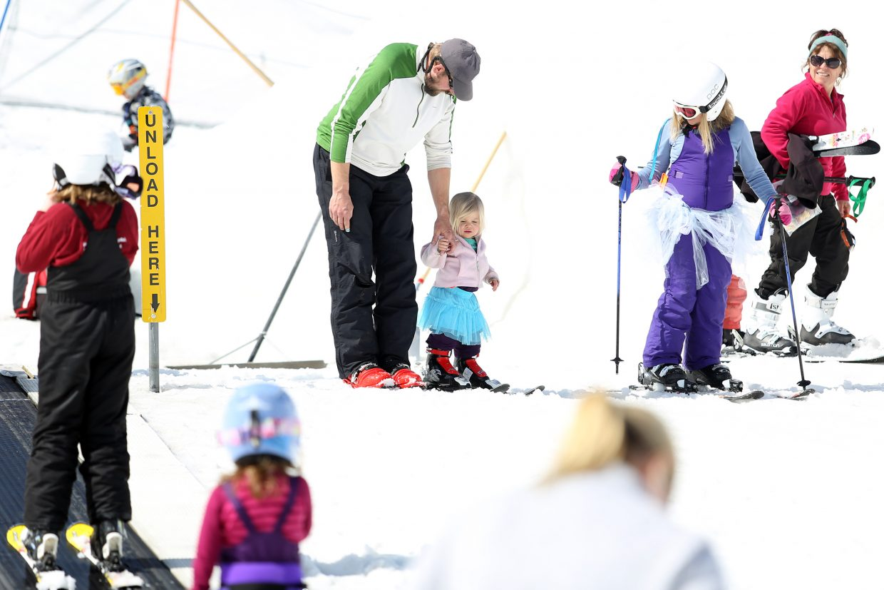 Families enjoy Howelsen Hill's free ski day on Sunday in Steamboat Springs.