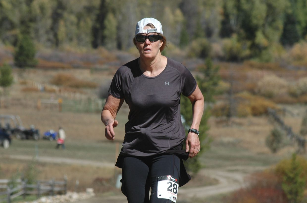 Robyn Jankoski heads down the final 400-meter stretch of the 5-mile race Sunday morning in Hahn's Peak Village. Jankoski finished in 1:17.40.