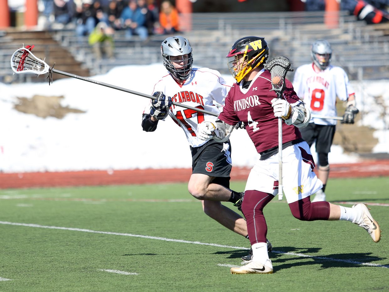 Steamboat Springs senior Jake Crouch, left, defends a Windsor player in Saturday's game at Gardner Field.
