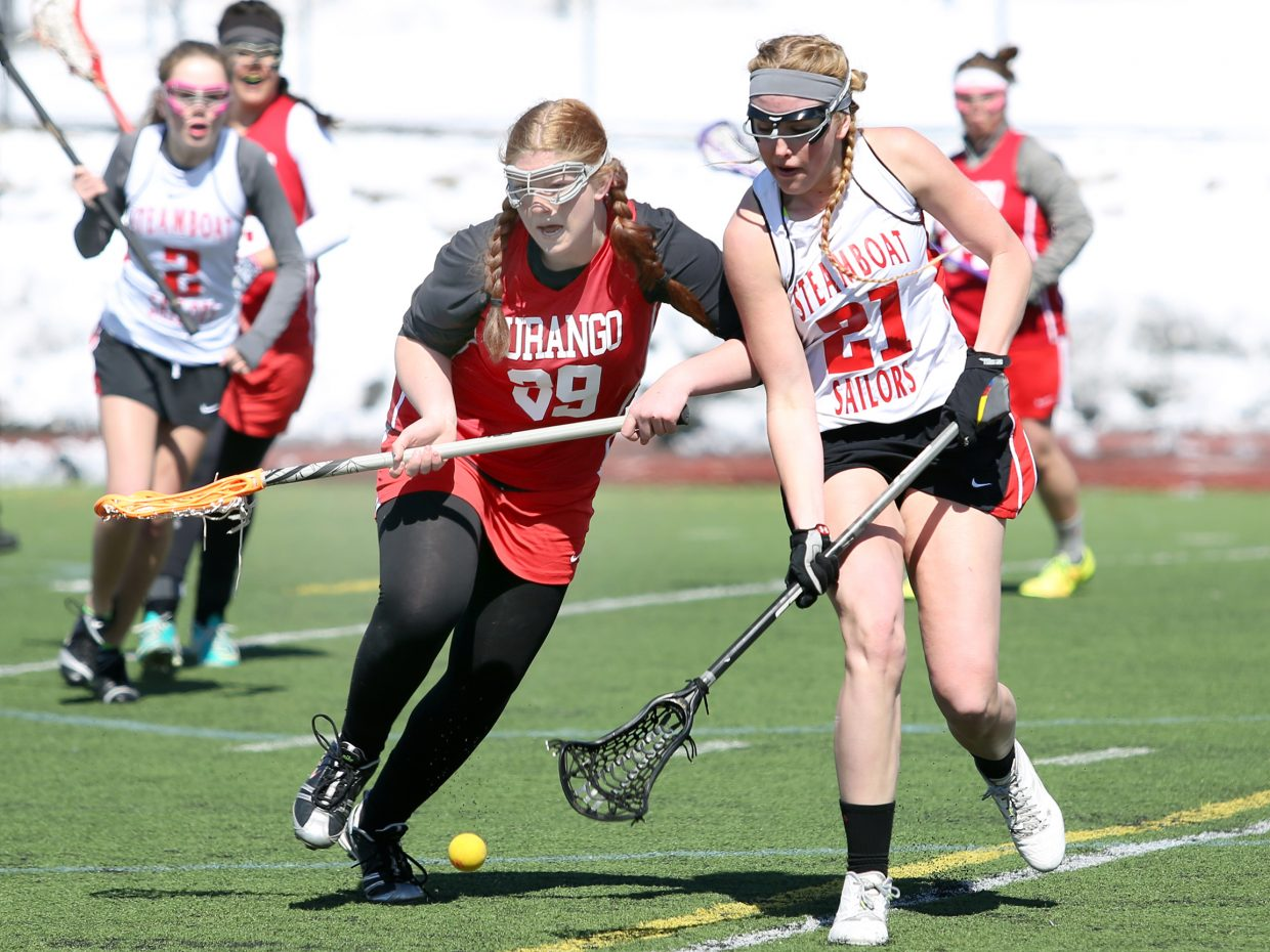 Steamboat Springs senior Becky Brown, right, and Durango's Grace Weaver fight for positioning in Saturday's game at Gardner Field. The Sailors won, 13-12, in overtime.