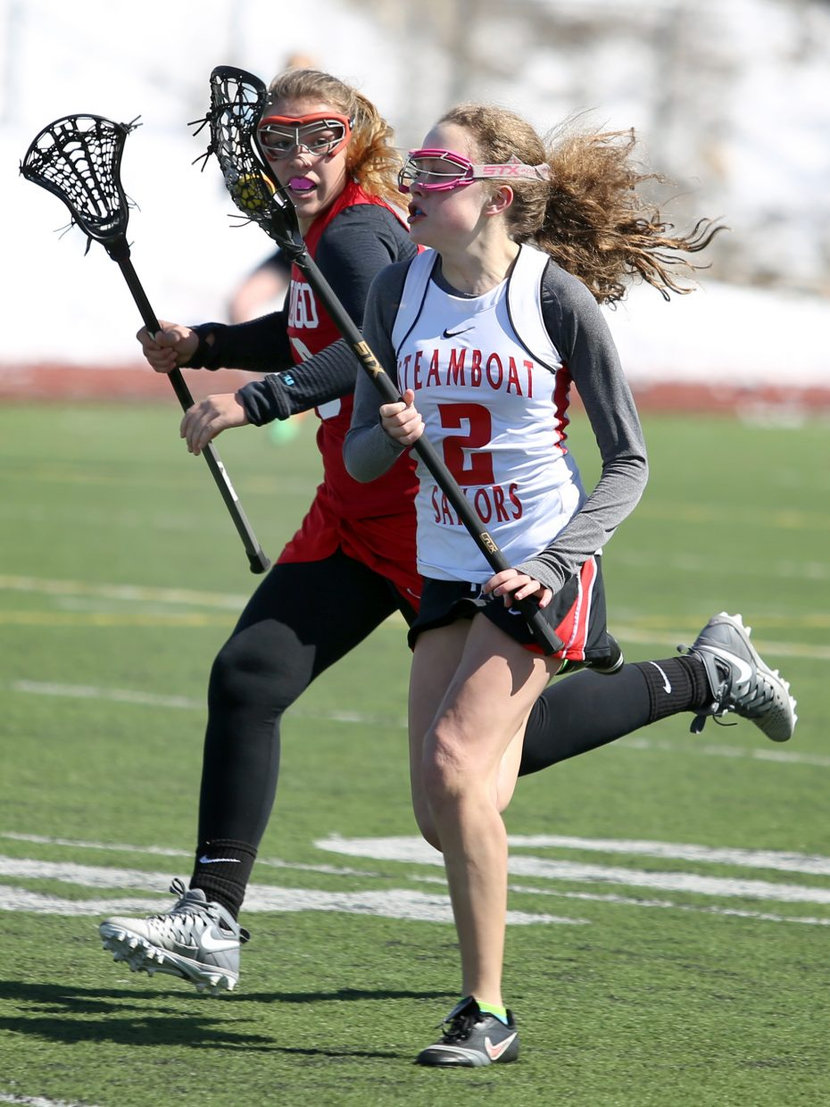 Steamboat Springs freshman Alicia Mitchell, right, brings the ball up field against Durango on Saturday at Gardner Field.