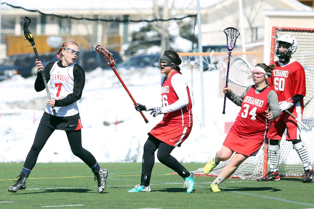 Steamboat Springs freshman Lucy Shimek, left, looks for an opening in the Durango defense Saturday at Gardner Field.