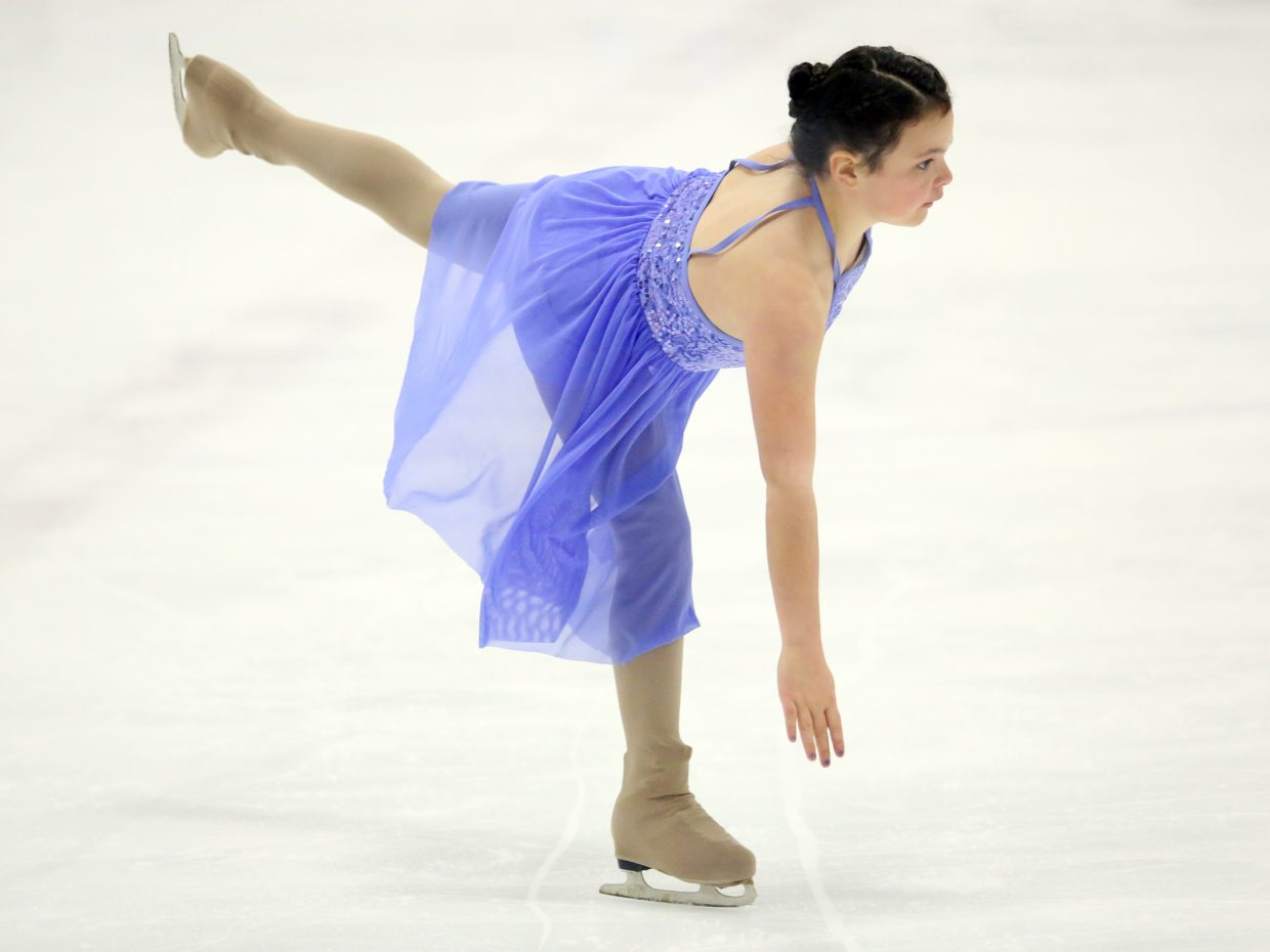 "Jacey Larock performs to ""Shark in the Water"" by V.V. Brown during Sunday's annual Steamboat Springs Figure Skating Club spring ice show at Howelsen Ice Arena."
