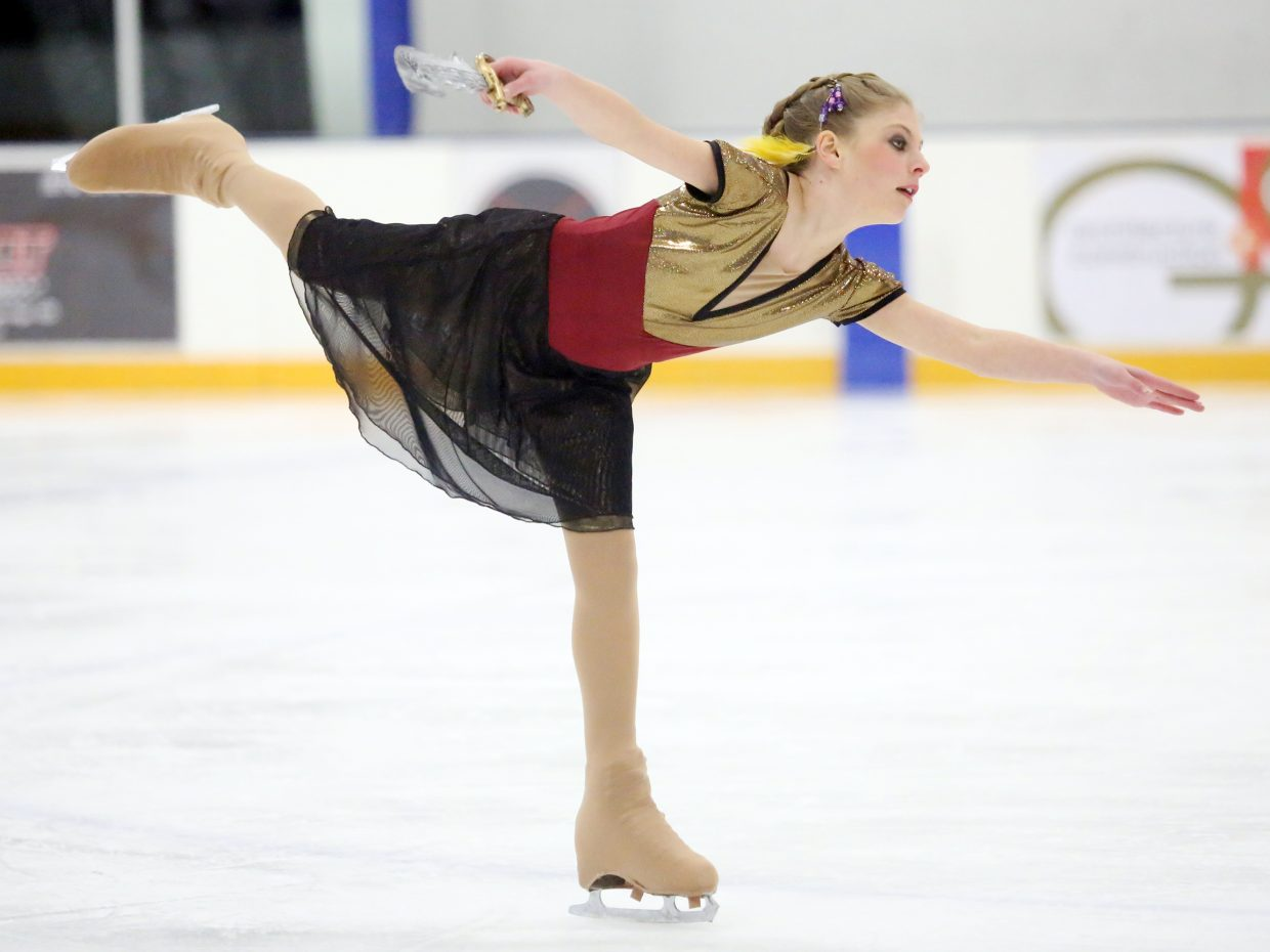 "Madison Van Engelenhoven, sword in hand, performs to the ""Pirates of the Caribbean"" theme song during Sunday's annual Steamboat Springs Figure Skating Club spring ice show at Howelsen Ice Arena."