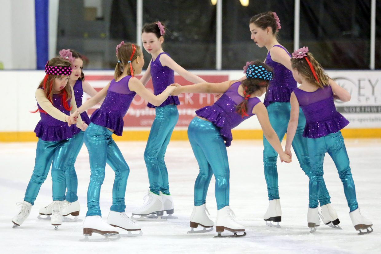 "Members of the ""Sequins to Rhinestones"" bridge program perform to ""Under the Sea"" from ""The Little Mermaid"" during Sunday's annual Steamboat Springs Figure Skating Club spring ice show at Howelsen Ice Arena."