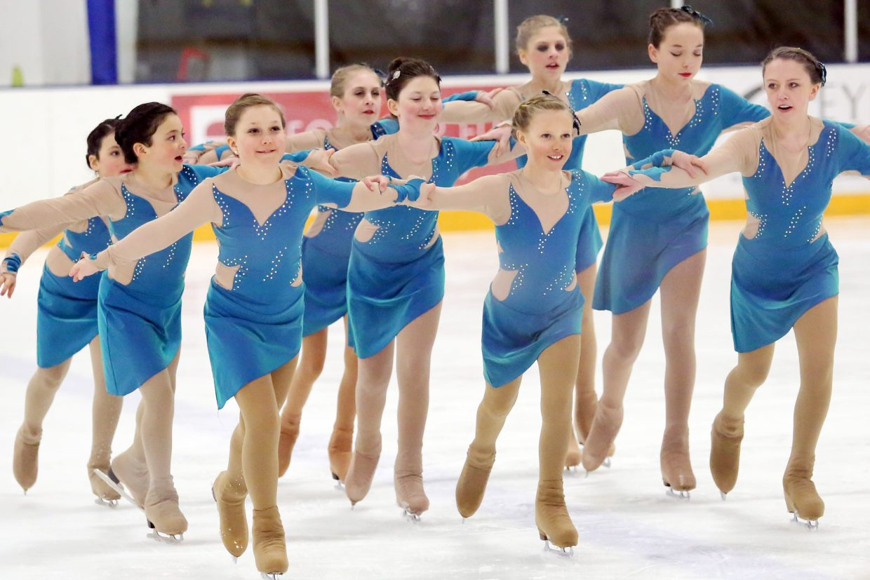 "Members of the SSFSC Synchro Team perform to ""Caribbean Blue"" by Enya during Sunday's annual Steamboat Springs Figure Skating Club spring ice show at Howelsen Ice Arena."
