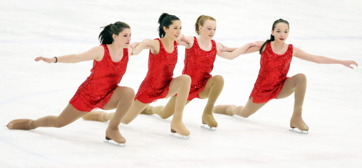 "From left, Sage Turek, Gillian Cook, Ava Maynard and Natahsa Curzon perform to ""S.O.S."" by Rhianna during Sunday's annual Steamboat Springs Figure Skating Club spring ice show at Howelsen Ice Arena."