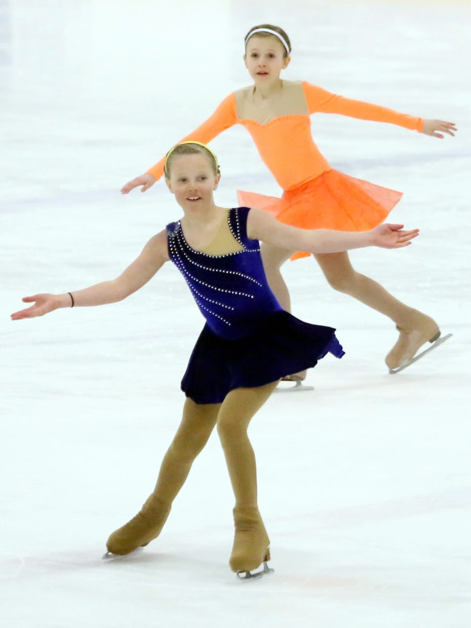 "Kaelyn Radway and Marisa Scott perform to ""Just Keep Swimmng"" from ""Finding Nemo"" during Sunday's annual Steamboat Springs Figure Skating Club spring ice show at Howelsen Ice Arena."