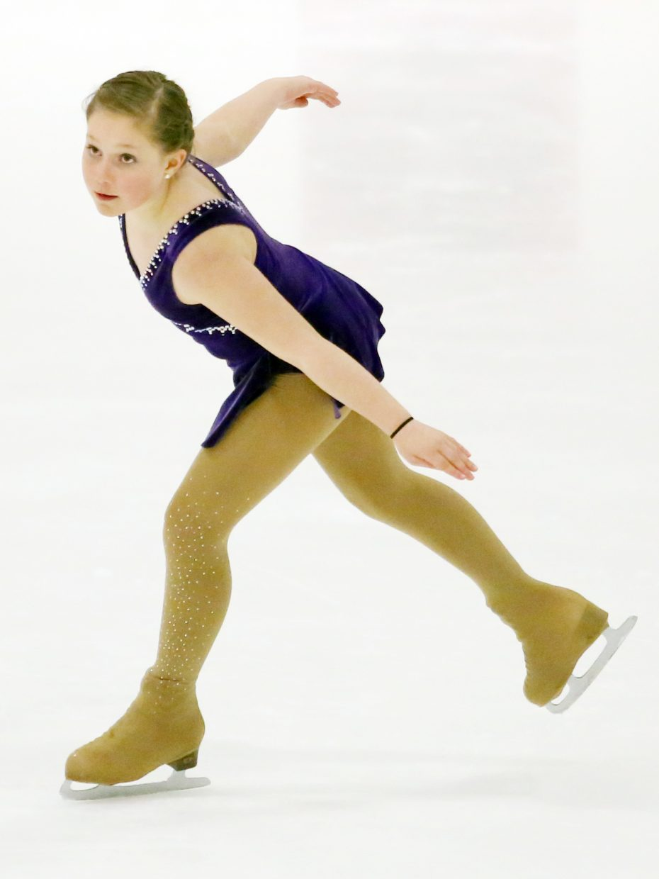 "Lily Frinks performs to ""Octopus's Garden"" by the Beatles during Sunday's annual Steamboat Springs Figure Skating Club spring ice show at Howelsen Ice Arena."